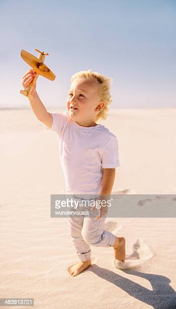 Child playing with his toy airplane