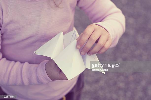 Child playing with paper game