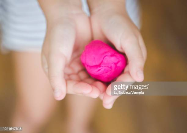 child playing with play dough - clay stock pictures, royalty-free photos & images
