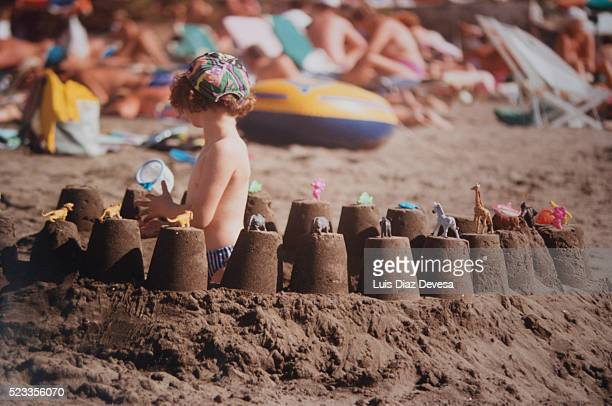 Child playing with sand at the beach