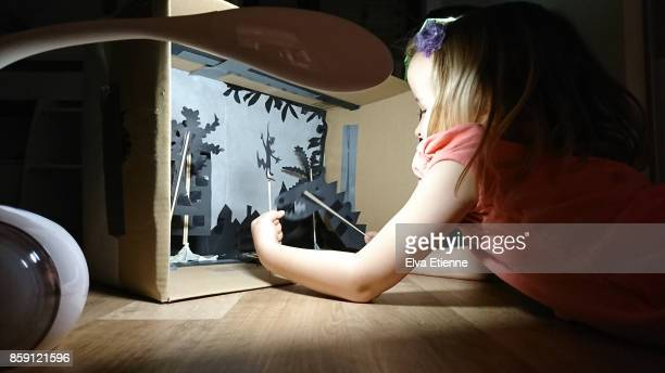 child playing with shadow puppet theatre - puppet show stock photos and pictures