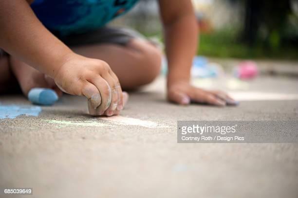 child playing with sidewalk chalk - regina saskatchewan stock pictures, royalty-free photos & images