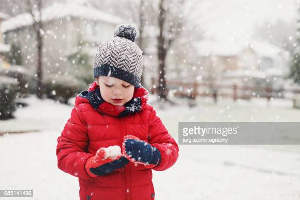 child playing with snow - mitten stock photos and pictures