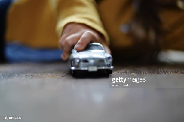 child playing with toy car - toy car stock pictures, royalty-free photos & images
