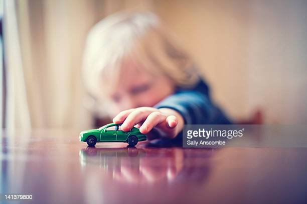 child playing with toy car - differential focus stock pictures, royalty-free photos & images