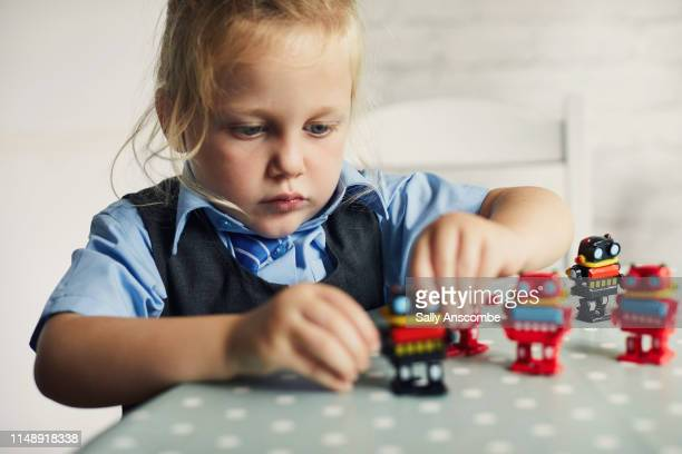 child playing with toy robots - playing stock pictures, royalty-free photos & images