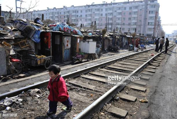 A child plays along a railway at a shanty town where residents will move into lowrent apartments provided by the government on March 11 2009 in...