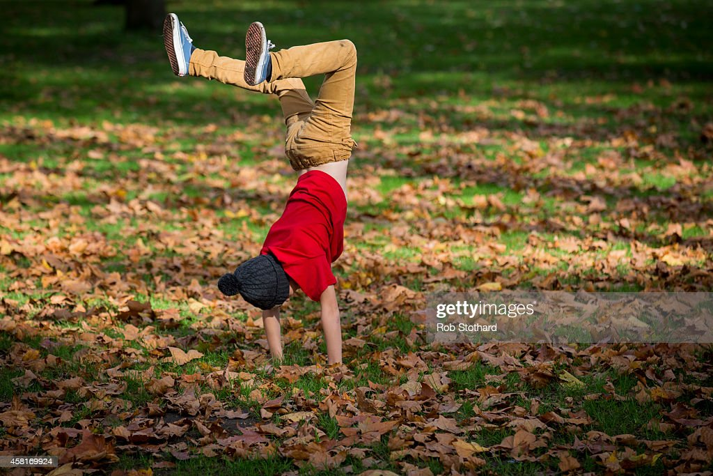 A child plays amongst the autumn leaves in Green Park on October 31, 2014 in London, England. Temperatures in London are forecasted to exceed 20 degrees making today the hottest Halloween on record.
