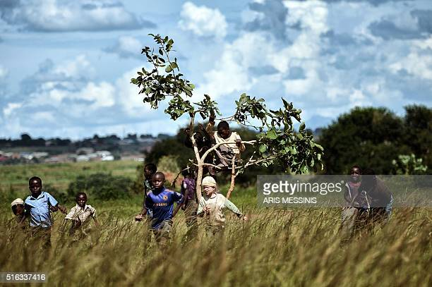 A child plays at a field at the outskirts of Lilongwe on March 11 2016 / AFP / ARIS MESSINIS