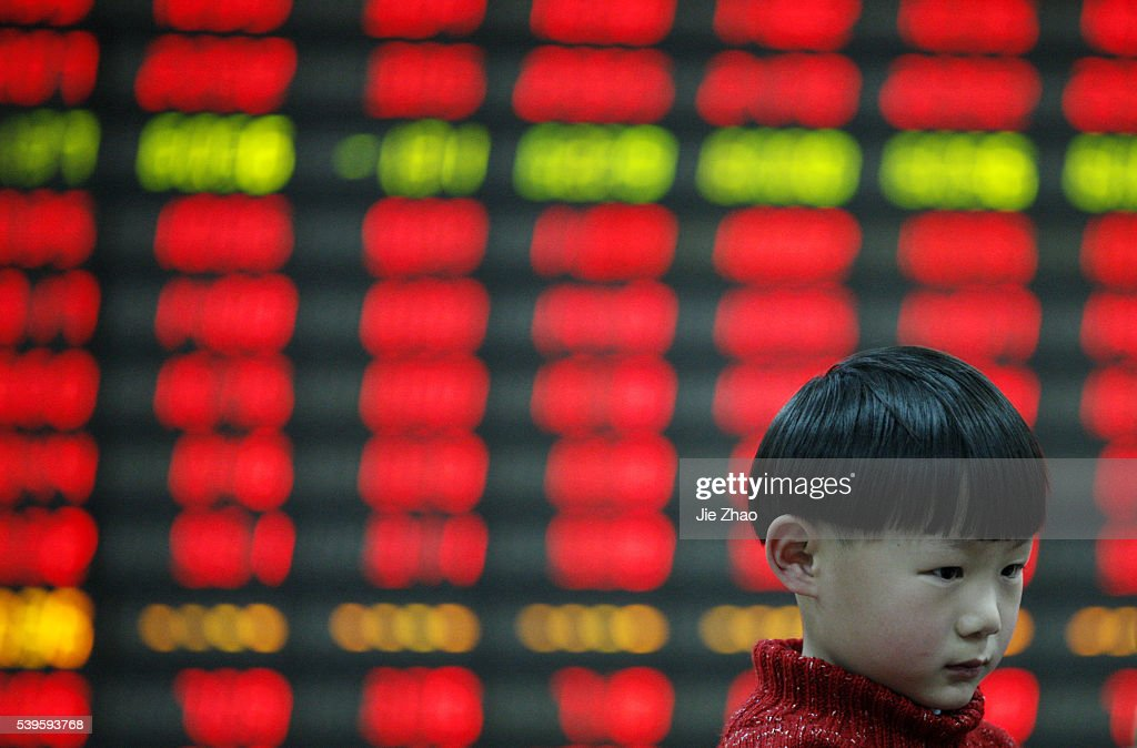 A child plays at a stock exchange in Huaibei , Anhui province, China on 10th April 2015. The Shanghai Composite Index climbed back above the 4,000 level and was poised for a fifth weekly increase. The Shanghai Composite rose 1.4 percent, poised for the highest close since March 2008. The CSI300 index rose 1.2 per cent. For this week, they looked set for gains of 3.9 per cent and 3.4 percent, respectively.