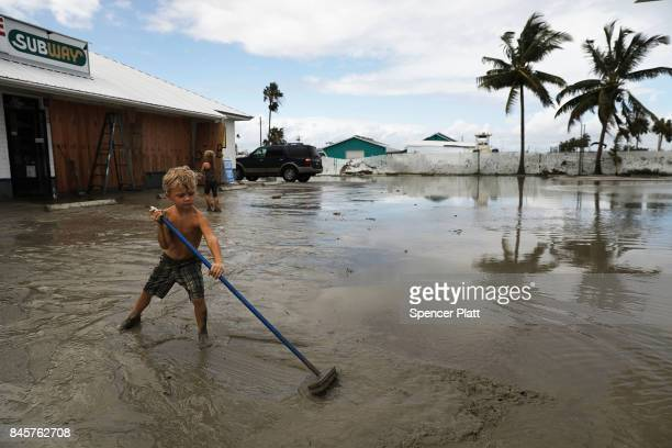 A child plays at his family's flooded gas station in the heavily damaged town of Everglades City the day after Hurricane Irma swept through the area...