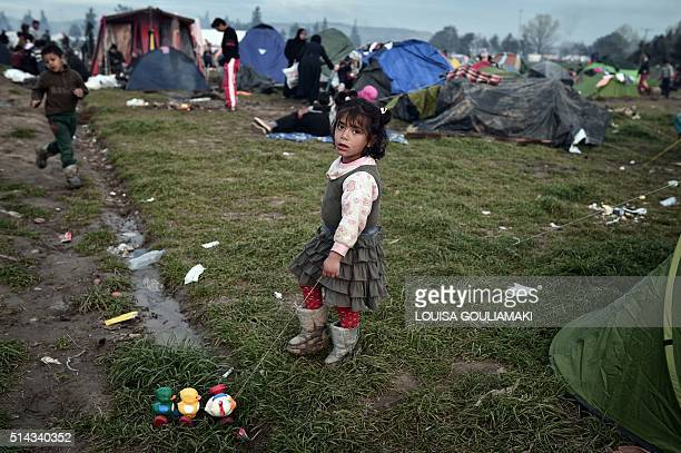 Child plays at the makeshift camp at the Greek-Macedonian borders, near the village of Idomeni, where thousands of refugees and migrants are stranded...