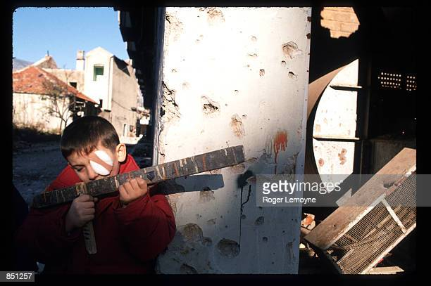 Child plays December 1, 1994 in Mostar, Bosnia-Herzegovina. When Bosnia declared its independence in March of 1992, the Bosnian Serbs set up local...