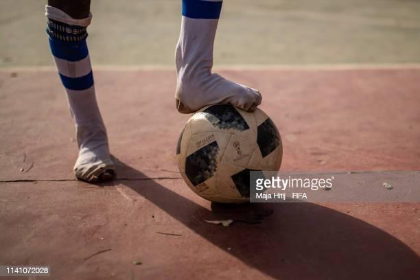 Child plays football during a FIFA Grassroots schools program on January 18 2019 in Dakar Senegal