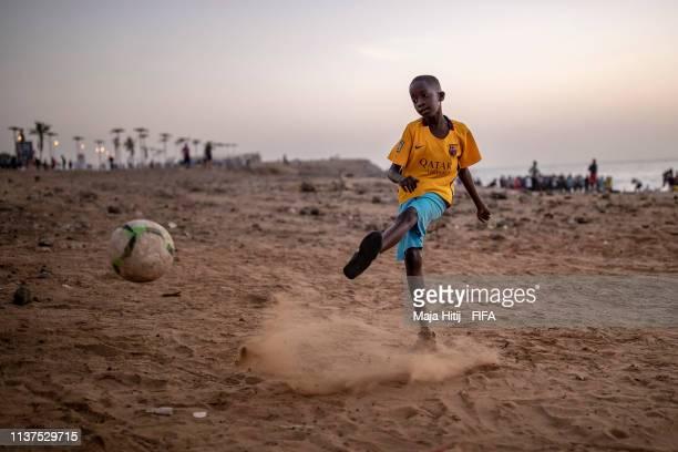 Child plays football near the beach on January 16 2019 in Dakar Senegal