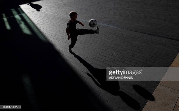 A child plays football outside the Royal Festival Hall in London on September 24 ahead of The Best FIFA Football Awards ceremony