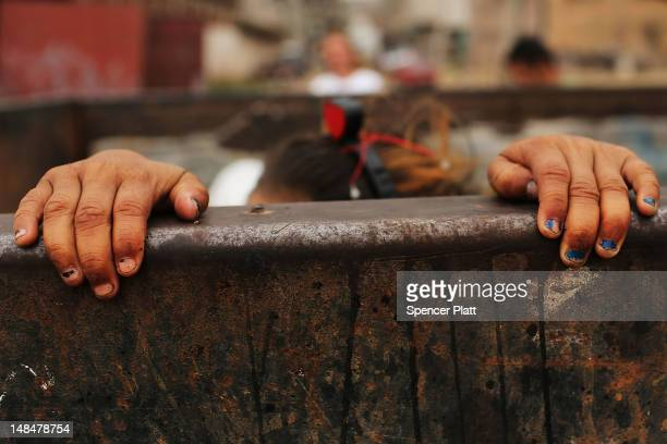 A child plays in a dumpster in a gang infested neighborhood on July 17 2012 in Tegucigalpa Honduras Honduras now has the highest per capita murder...
