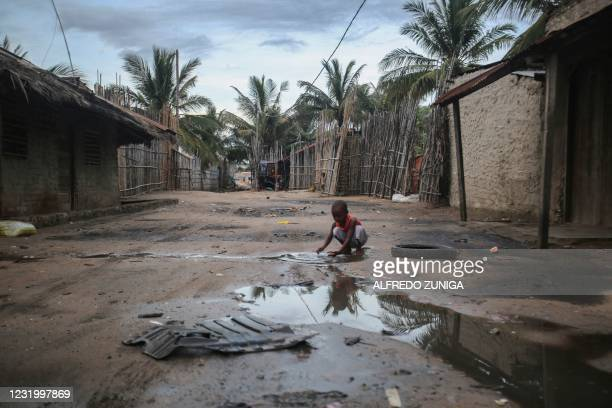 Child plays in one of the alleys of the port of Paquitequete near Pemba on March 29, 2021. Sailing boats are expected to arrive with people displaced...