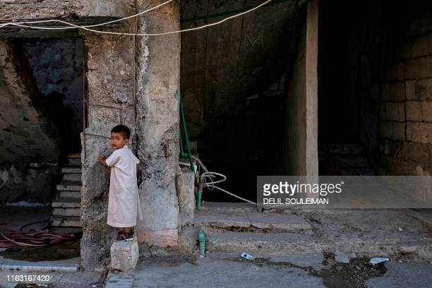 Child plays in the northern Syrian city of Raqa, the former Syrian capital of the Islamic State group, on August 21, 2019. - The Kurdish-led Syrian...