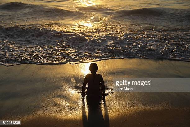 A child plays in the Pacific surf near the USMexico border fence on September 25 2016 in Tijuana Mexico The nearby Friendship Park is one of the few...