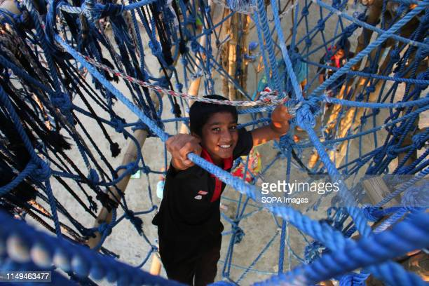 A child plays inside the bamboo play space in Dhaka The unique play space built in Dhaka has brought smiles on the faces of local and underprivileged...