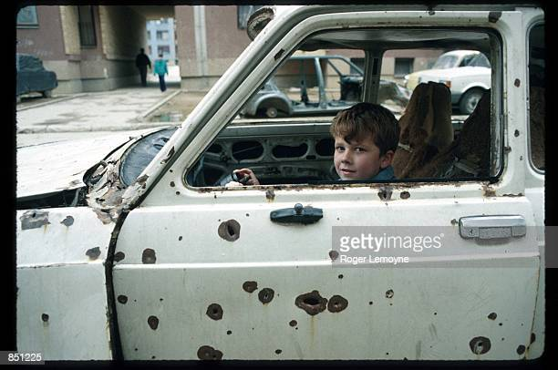 A child plays inside the wreckage of a car December 1 1994 in Sarajevo BosniaHerzegovina When Bosnia declared its independence in March of 1992 the...