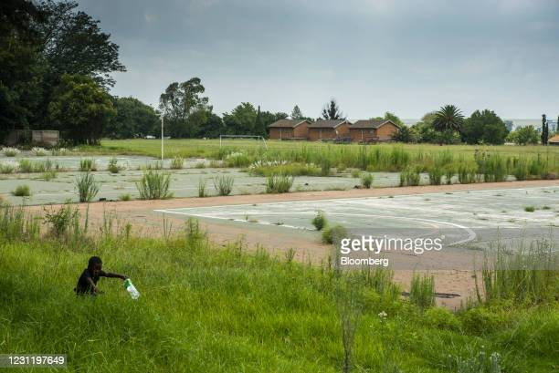 Child plays near a derelict sports pitch in Mpumalanga, South Africa, on Tuesday, Jan. 12, 2021. In South Africa, for decadesalmost all the...