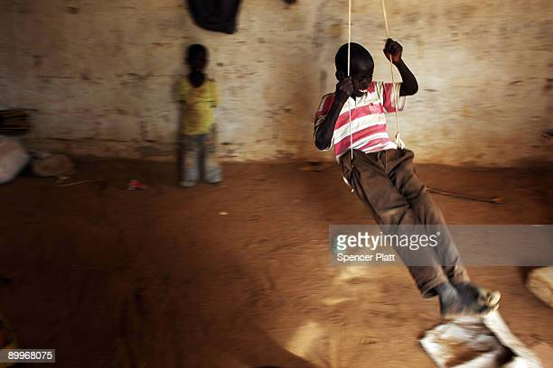 Child plays on a swing at a home in Dadaab, the world�s biggest refugee camp August 20, 2009 in Dadaab, Kenya. The Dadaab refugee complex in...