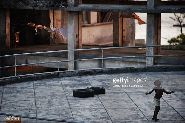 A child plays on one of the main terrace of the Grand hotel Beira on November 2 2010 in Beira Mozambique The Grande Hotel Beira was a luxury hotel in...