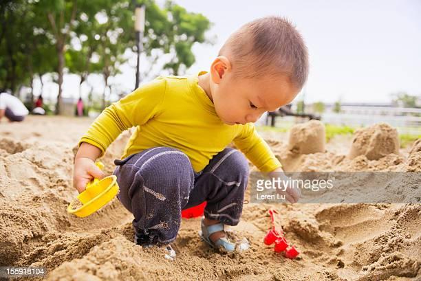 Child plays on sandpit