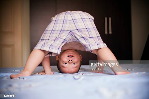 child plays on the bed - bent over babes stock pictures, royalty-free photos & images