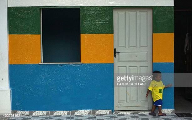 A child plays on the street prior to the first match of Brasil against Croatia in Porto Seguro during the 2014 FIFA World Cup on June 12 2014 AFP...