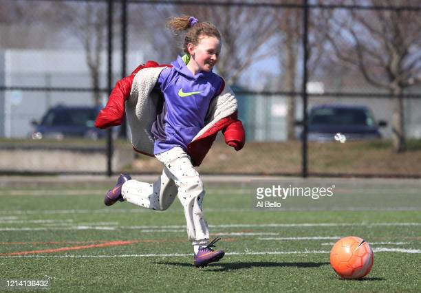 Child plays soccer at Cedar Creek Park on March 22, 2020 in Seaford, New York. It has been encouraged that people keep a social distance of six feet...