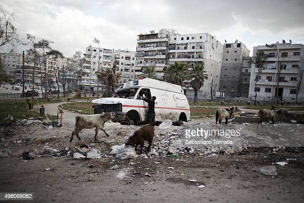 A child plays with a abandoned ambulance in a neighborhood of Aleppo Syria March 27 2013