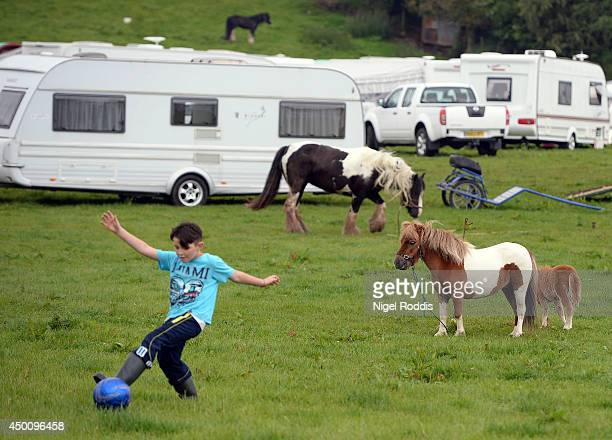 A child plays with a ball during the Appleby Horse Fair on June 5 2014 in Appleby England The Appleby Horse Fair has existed under the protection of...