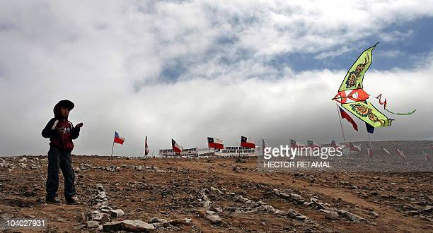 A child plays with a kite in the San Jose mine in Copiapo 800 km north of Santiago on September 12 2010 The 33 still trapped miners have become...