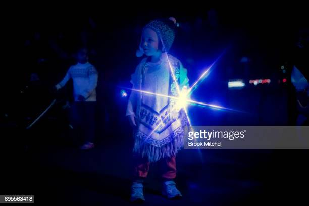 A child plays with a novelty light during the Vivid Festival on June 13 2017 in Sydney Australia Vivid Sydney is an annual festival that features...