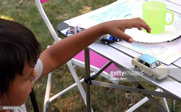 A child plays with a selfpowered toy Trabant automobile at a Trabant enthusiasts' weekend on August 8 2015 near Nossen Germany The Trabant also...