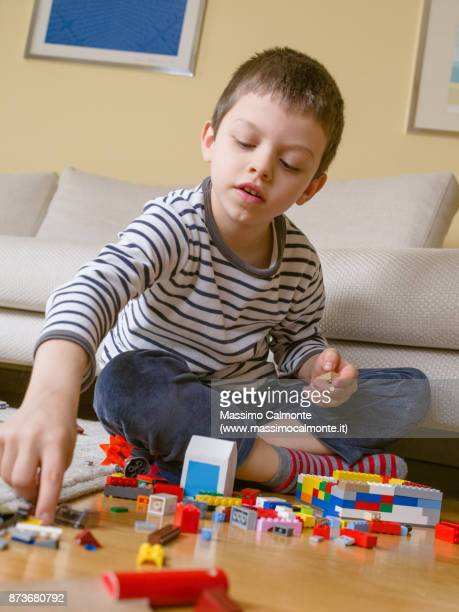 child (7 years) plays with constructions - 6 7 years stock pictures, royalty-free photos & images