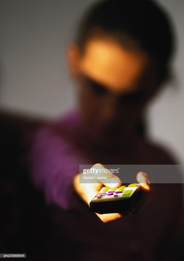 Child pointing remote, blurred. : Stockfoto