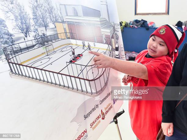 A child points to the rendering of the new rink during the 2017 Scotiabank NHL100 Classic Legacy Project press conference at the Boys Girls Club...