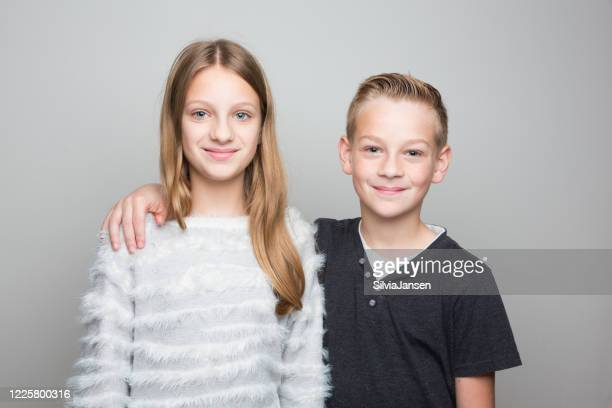 child portrait: brother and sister - sister stock pictures, royalty-free photos & images