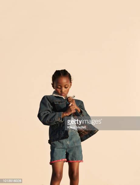 child portrait on studio background - double denim stock photos and pictures