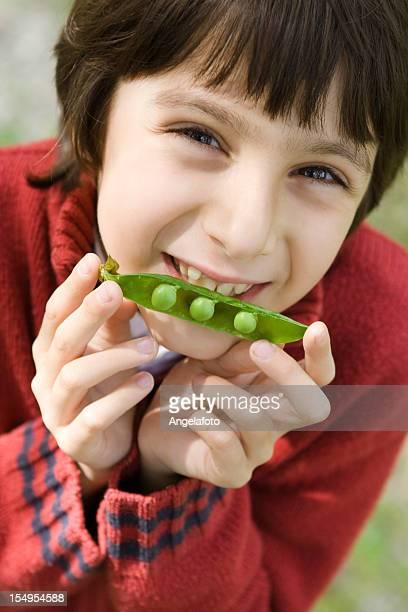 Child Portrait with a Peas Pod