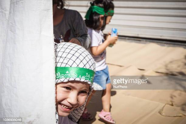 A child pose for a photograph prior the annual commemoration Ashura in Pireaus 20 September 2018 Hundreds of Shiite Muslims gathered in Piraeus to...