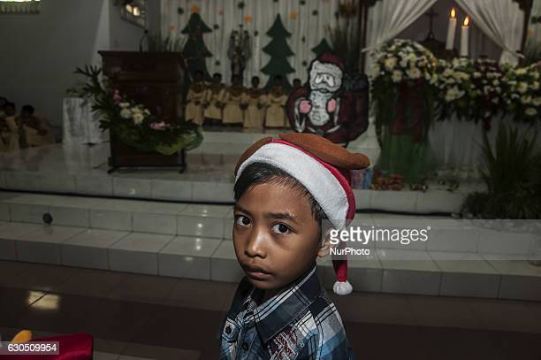 A child pose when attend mass in celebration of Christmas in Sacred Heart of Jesus Catholic Church in Yogyakarta Indonesia on December 25 2016 Today...