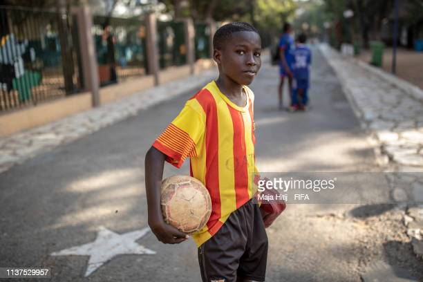 Child poses for a portrait during a FIFA Grassroots schools program on January 16 2019 in Dakar Senegal