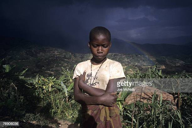 A child poses in December of 1996 in front of Rwanda's landscape In 1994 Rwanda saw one of the worlds worst act genocide to date At least 500000...