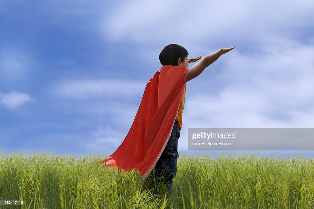 Child posing as Superman : Stock Photo
