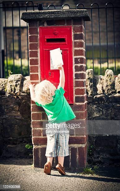 Child posting letter